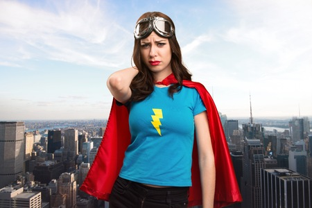 super woman: Pretty superhero girl with neck pain with the city in the background