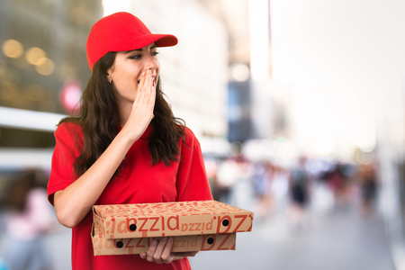 Pizza delivery woman shouting on unfocused background