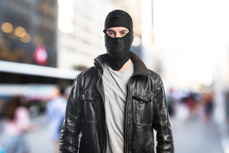 Robber wearing a leather jacket Stock Photo