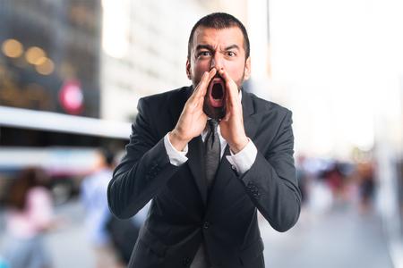 Businessman shouting Stock Photo