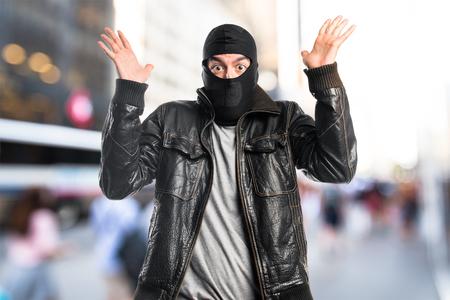Robber doing surprise gesture