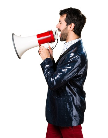 Man with jacket shouting by megaphone Stock Photo