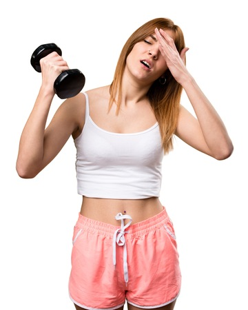 Frustrated bbeautiful sport woman with dumbbells
