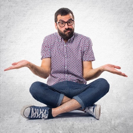 Man with glasses making unimportant gesture Stock Photo