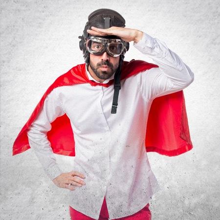 Crazy superhero man showing something
