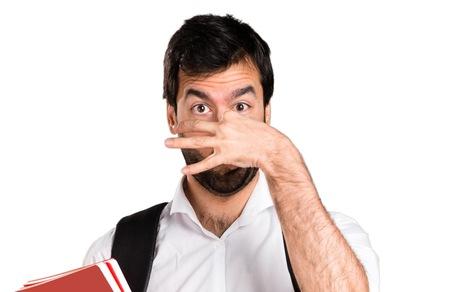 Student man making smelling bad gesture