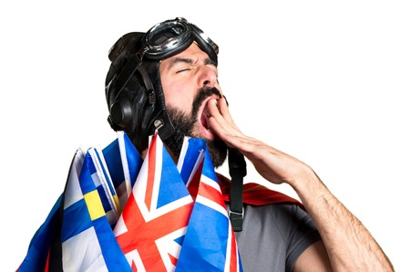 bilingual: Superhero with a lot of flags yawning