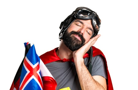 bilingual: Superhero with a lot of flags making sleep gesture Stock Photo