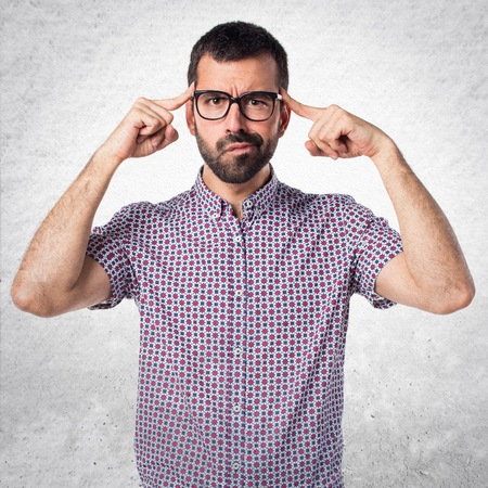 Man with glasses thinking Stock Photo