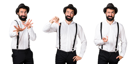disapprove: Hipster man with beard making bad signal