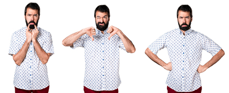 disapprove: Handsome brunette man with beard making bad signal