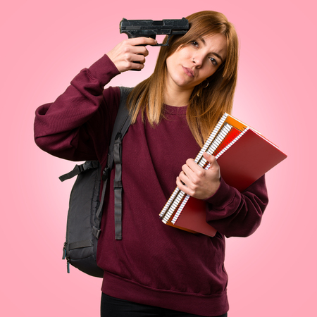 Student woman cometing suicide on colorful background Stock Photo