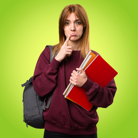 disapprove: Sad student woman on colorful background Stock Photo