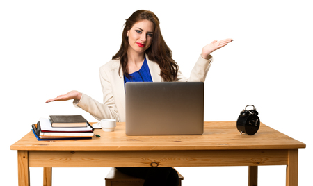 Business woman working with her laptop and making unimportant gesture