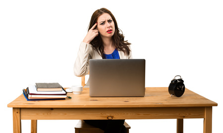Business woman working with her laptop and making crazy gesture Stock Photo