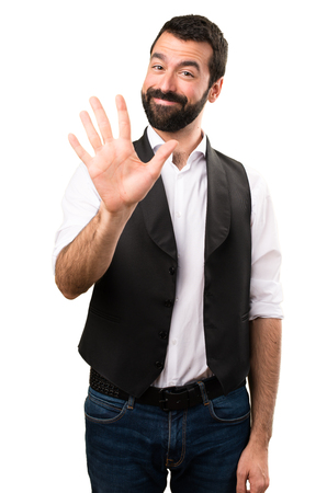 Cool man counting five on isolated white background Stock Photo