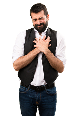 Cool man with heart pain on isolated white background