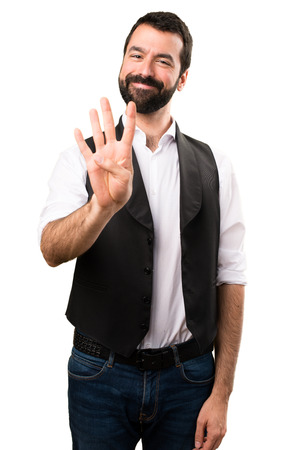 Cool man counting four on isolated white background