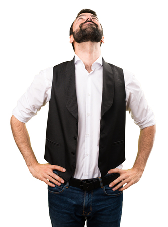 vest in isolated: Cool man looking up on isolated white background