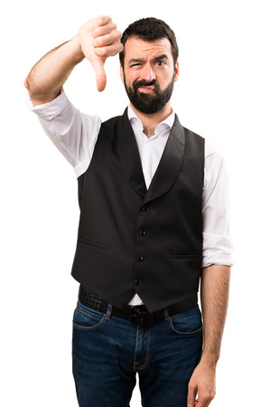 Cool man making bad signal on isolated white background