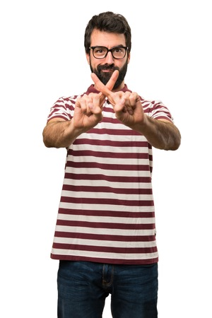 Man with glasses making NO gesture