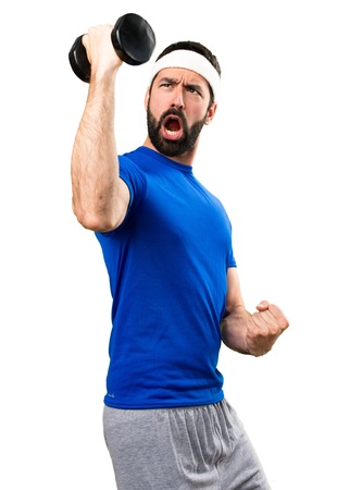 Funny sportsman making weightlifting on isolated white background Фото со стока