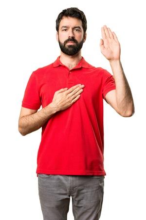Handsome man making an oath