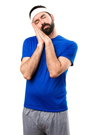 Funny sportsman making sleep gesture on isolated white background