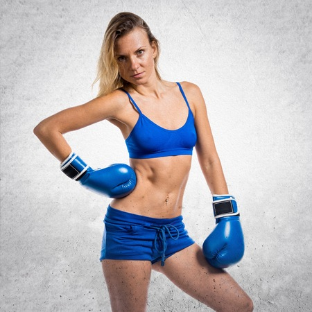 Pretty blonde woman with blue boxing gloves