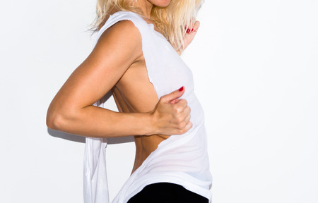 Beautiful blonde woman with wet t-shirt
