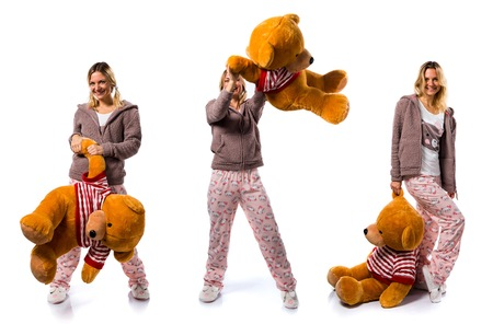 Pretty blonde girl in cute pajamas with big stuffed animal