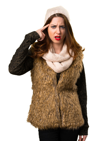Girl with winter clothes making crazy gesture Stock Photo