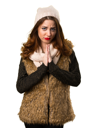 Girl with winter clothes pleading Stock Photo