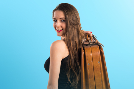 Young girl holding a briefcase Stock Photo