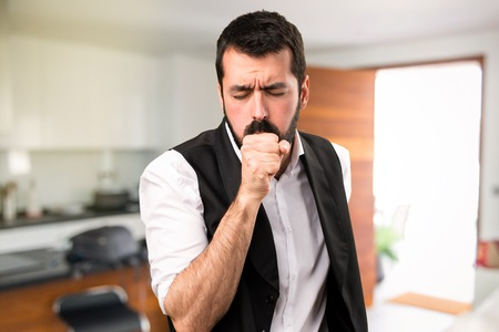 Cool man coughing a lot inside house