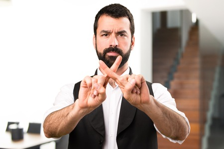 Cool man making NO gesture inside house Stock Photo