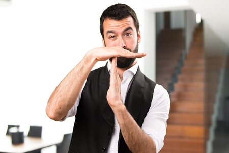 Cool man making time out gesture inside house