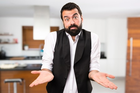 Cool man making unimportant gesture inside house Stock Photo