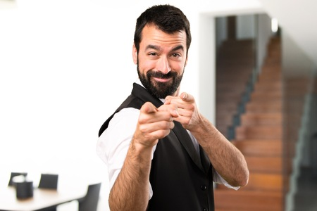 Cool man pointing to the front inside house