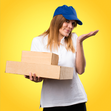 Delivery woman making unimportant gesture on colorful background
