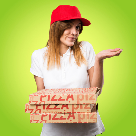 Pizza delivery woman making unimportant gesture on colorful background