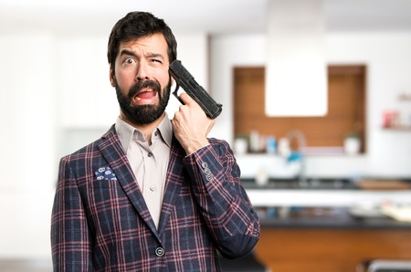 Well dressed man cometing suicide inside house Stock Photo
