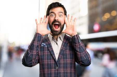 Well dressed man making surprise gesture in the city Stock Photo