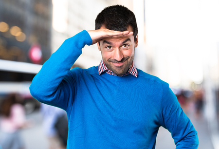 Handsome young man showing something on unfocused background Stock Photo