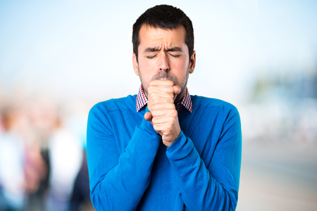 Handsome young man coughing a lot on unfocused background Stok Fotoğraf - 93812948