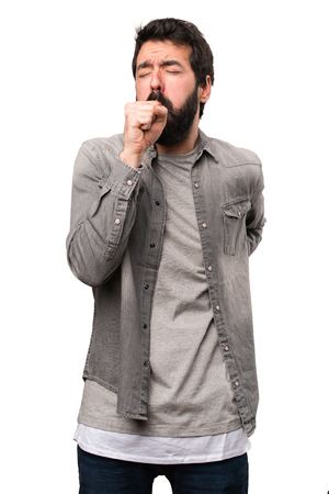 Handsome man with beard coughing a lot on white background