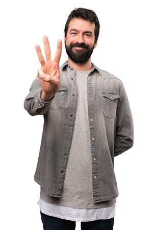Handsome man with beard counting three on white background