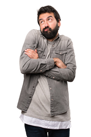 Handsome man with beard making unimportant gesture on white background Stock Photo