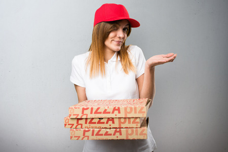 Pizza delivery woman making unimportant gesture on textured background