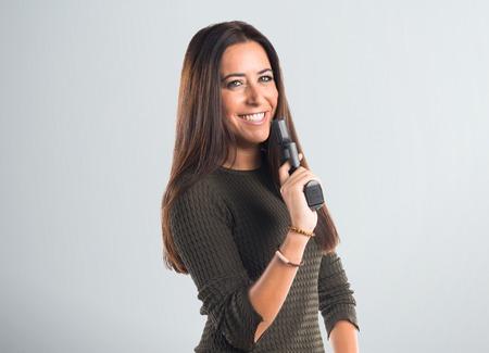 Woman holding a pistol Archivio Fotografico